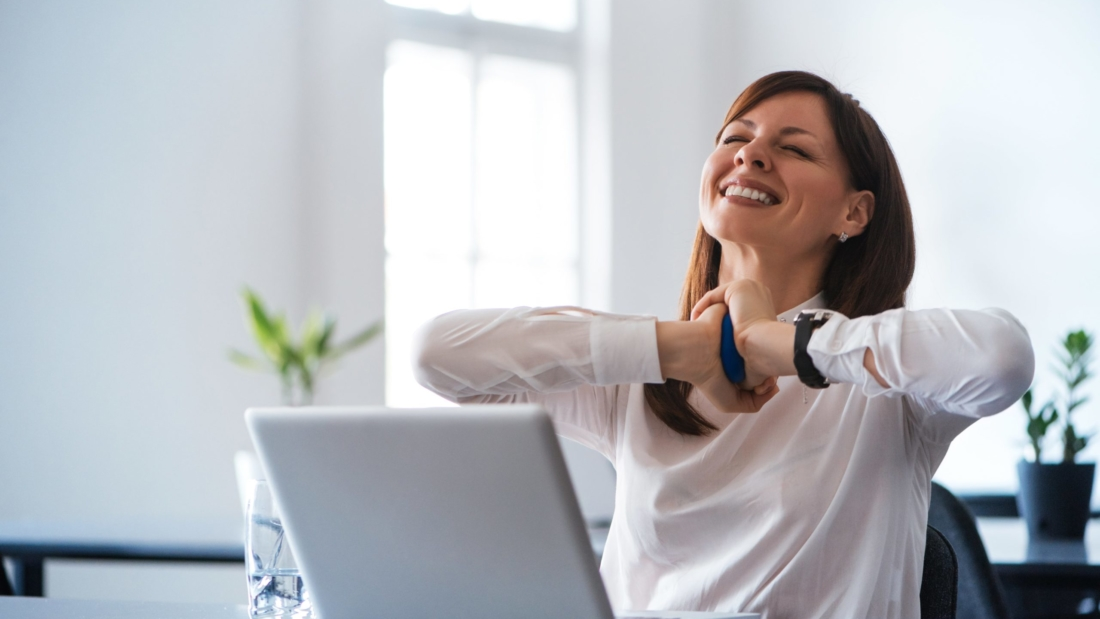 Woman happy about SEO tactics working for her hearing practice website