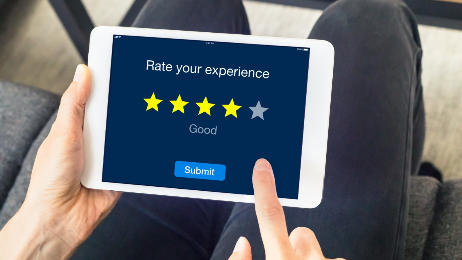 Person leaves a rating on tablet
