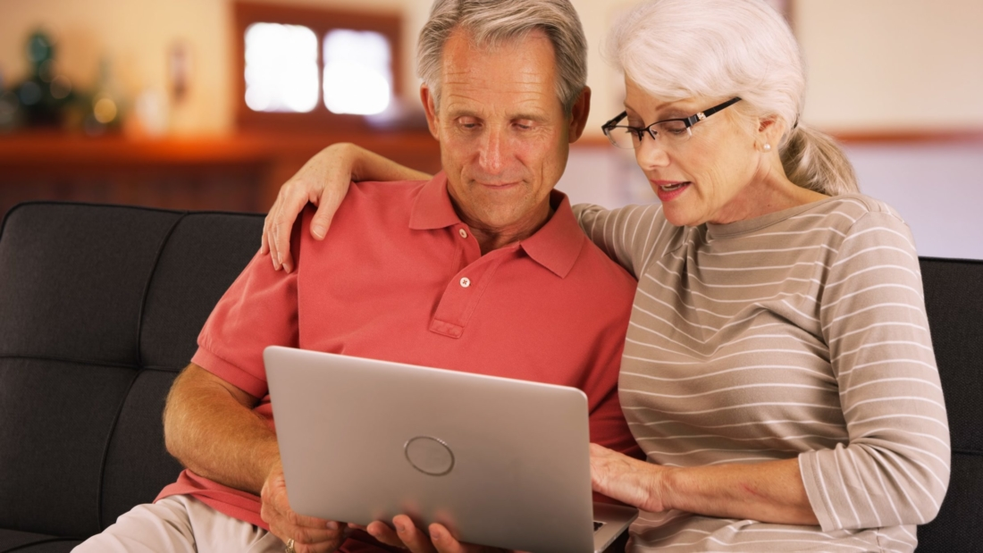 Man and Woman look at computer together