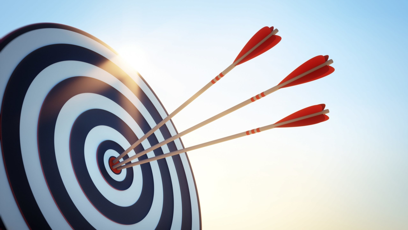 3 arrows in the bulls-eye of a target