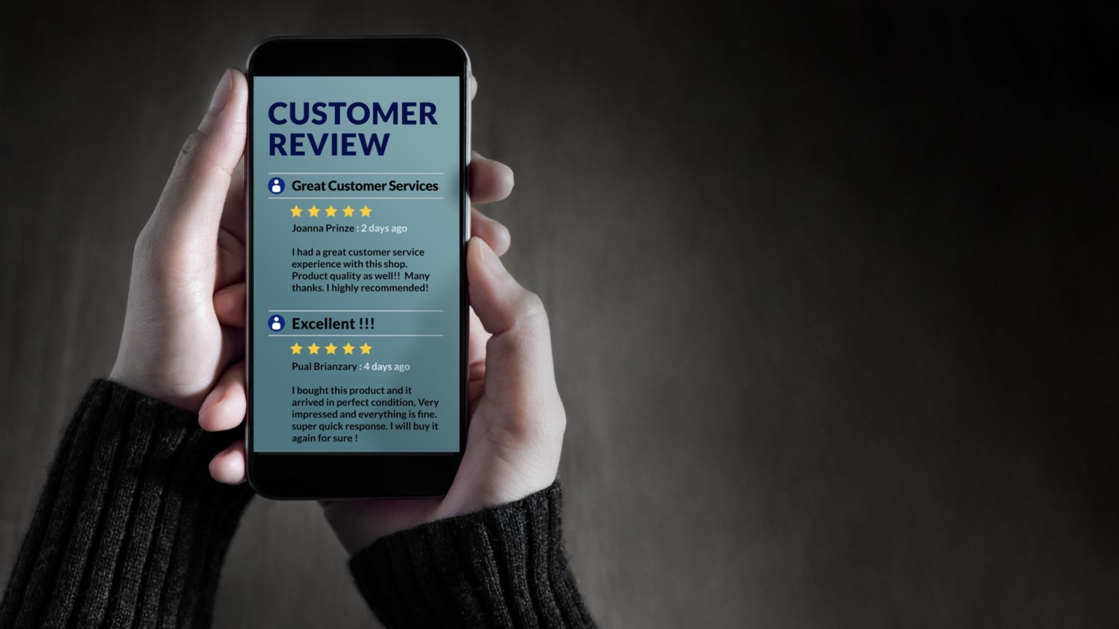 A person holds a phone with customer reviews on it
