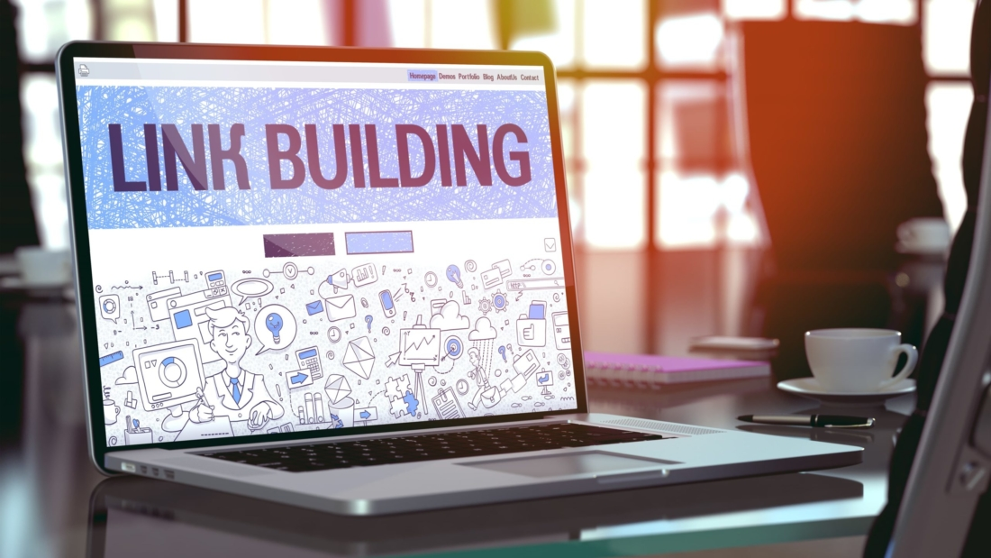 link building text on laptop screen