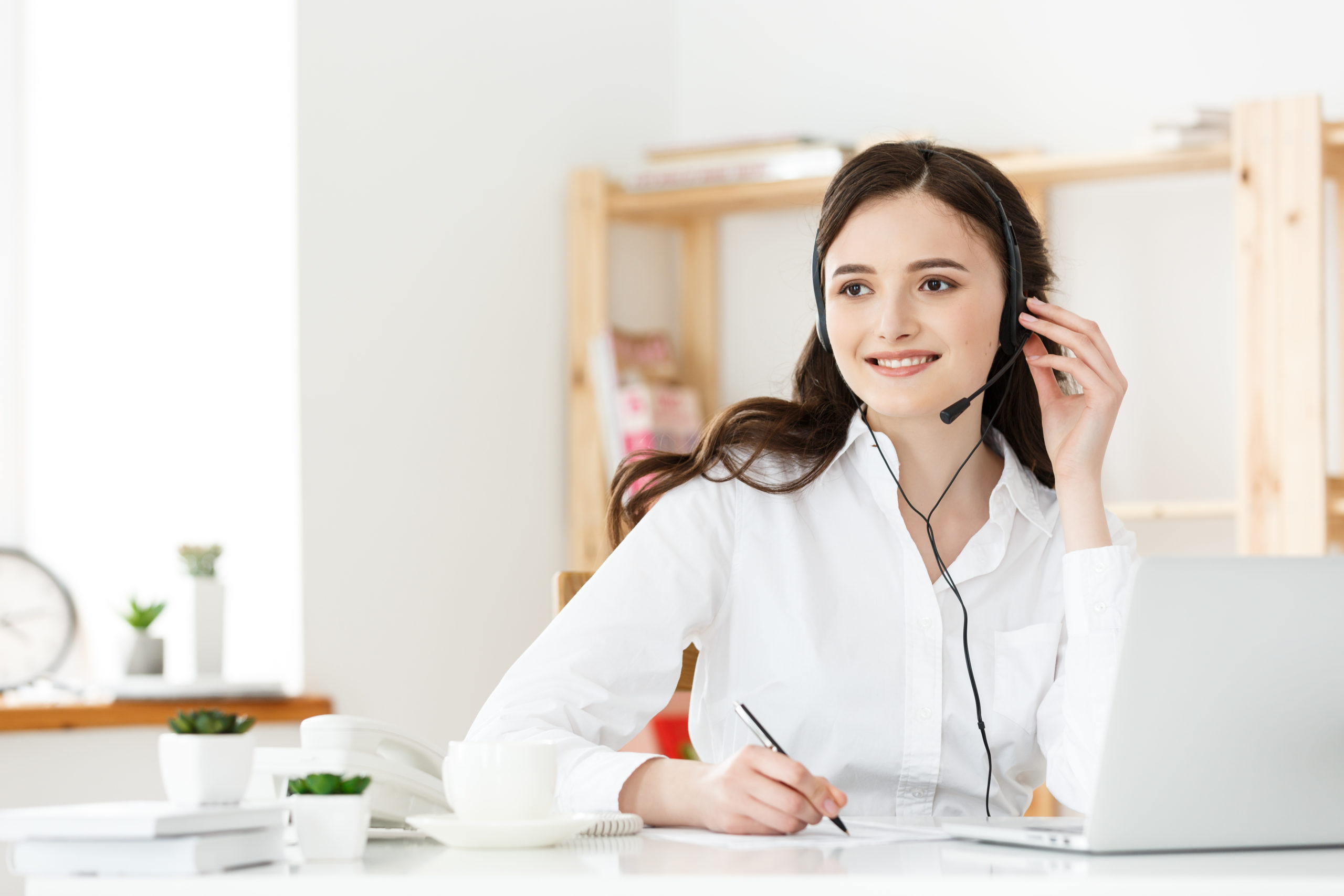 Call Center Concept: Portrait of happy smiling female customer support phone operator at workplace